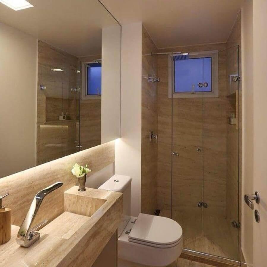 banheiros pequenos decorados com pia esculpida em mármore Foto Sandra Stever