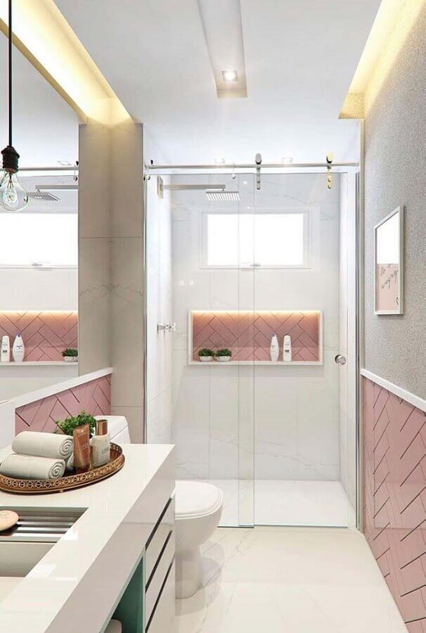 decoração delicada para banheiro pequeno e moderno com subway tile rosa e bancada branca Foto Pinterest