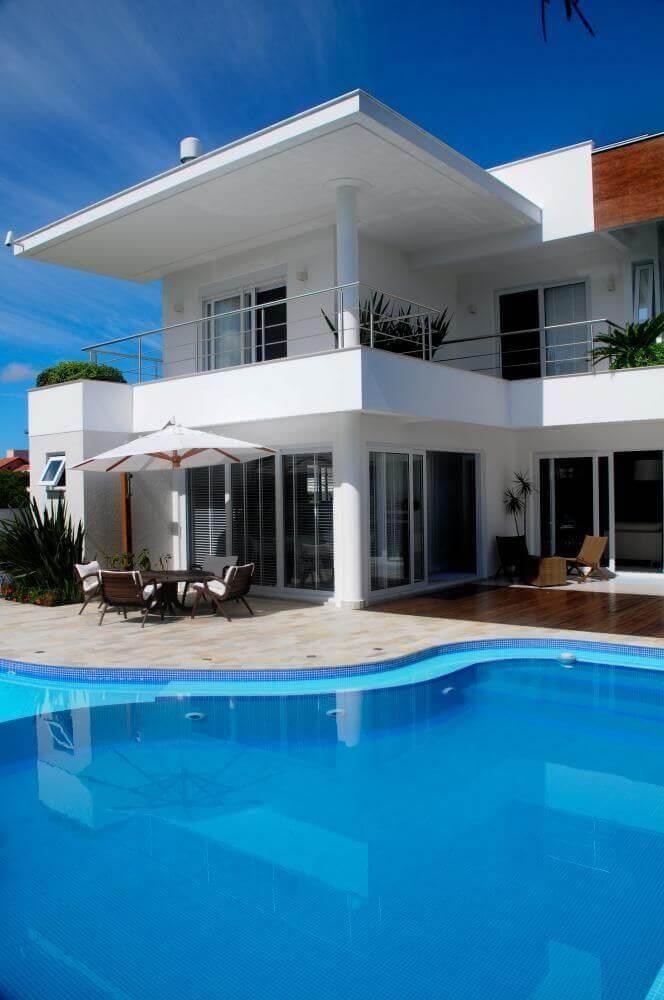 casas com piscina curva e area de lazer juliana pippi 66125