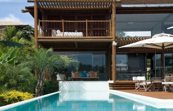 casas com piscina guarda sol e cadeiras sq arquitetos associados 65562