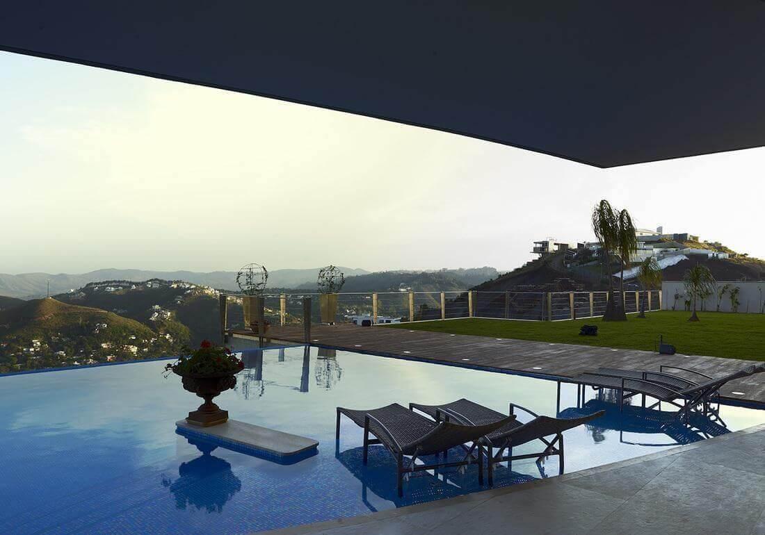 casas com piscina infinita paisagem e gramado angela pinho 67700