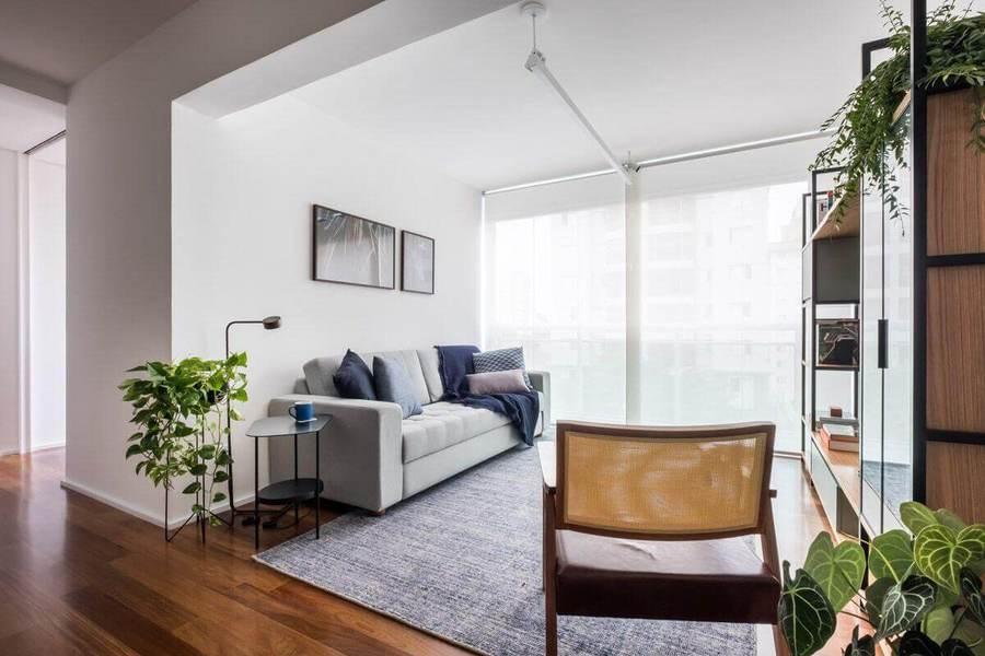 Plantas para apartamento - estante metálica preta vazada com caixotes claros