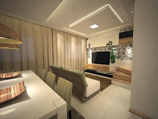 Sala de estar com teto de gesso baixo iluminado Projeto de Ednilson Hin