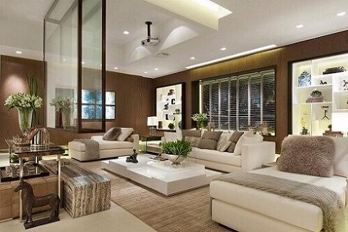 Sala de estar com teto de gesso e iluminação interna Projeto de Quitete Faria