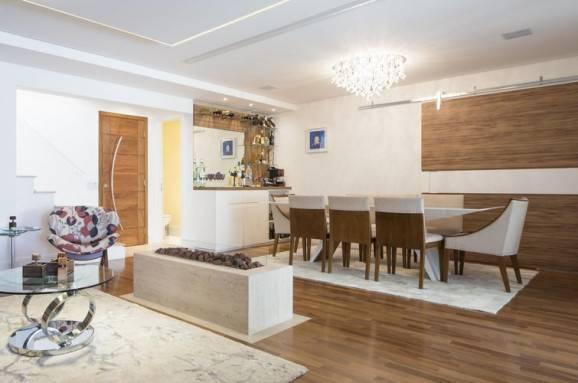 Sala de jantar, com design contemporâneo que prioriza beleza e comodidade.