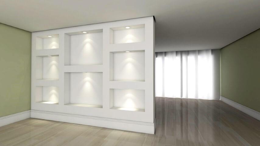 Parede de gesso com nichos e iluminação embutida