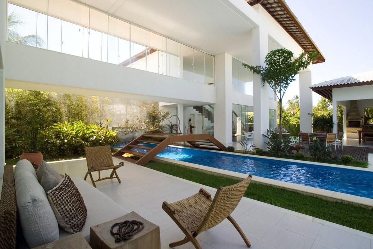 piscina de alvenaria com ponte sq arquitetos associados 65530
