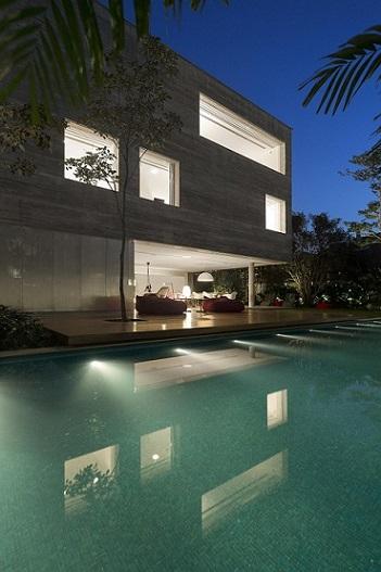 Casa cinza com telhado embutido Projeto de Studio MK27