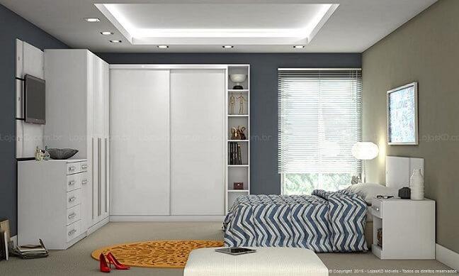 Quarto de casal planejado com luminária ao lado da cama Projeto de Lojas KD