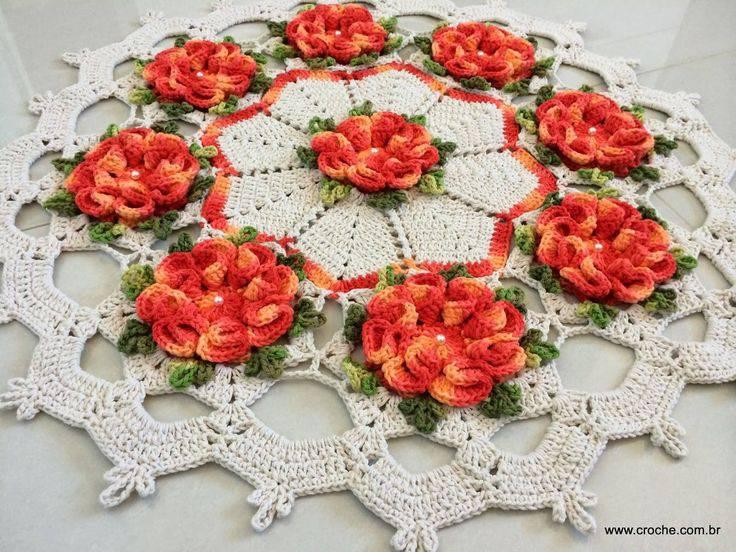 tapetes de barbante circular com flores laranjas