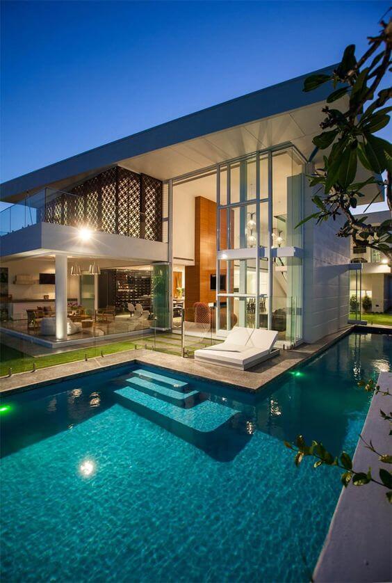 Fachadas de casas modernas com piscina