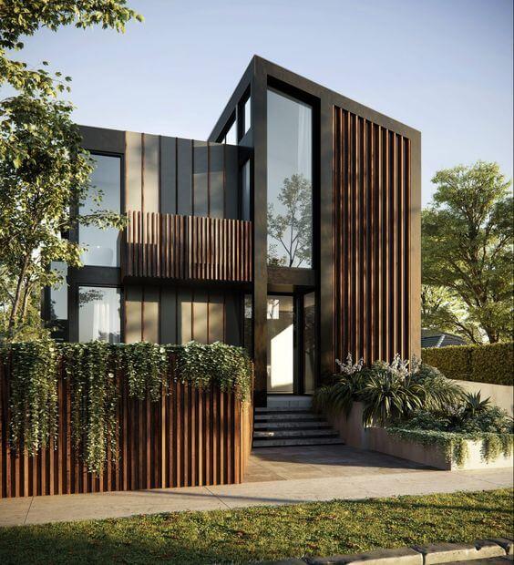 Fachadas modernas com madeira e janela de vidro