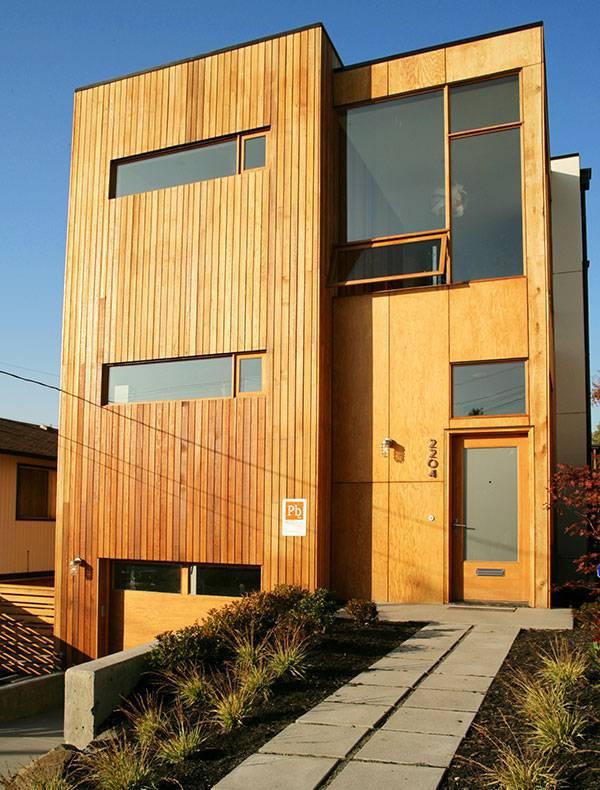 casas de madeira com fachada reta