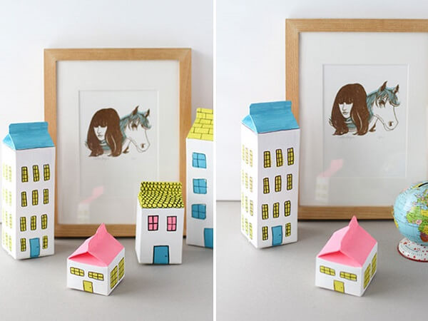 Utilize caixa de leite para formar casas e prédios