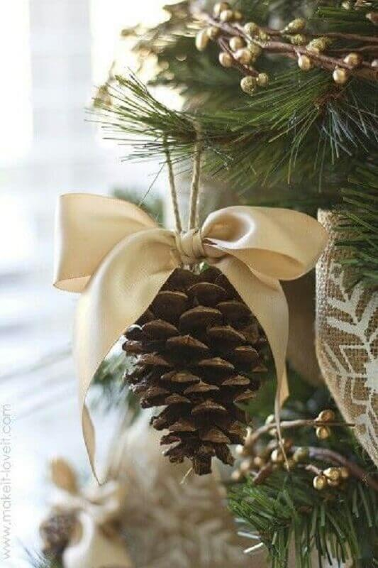Beautiful Christmas tree ornament with pinecones and satin ribbon