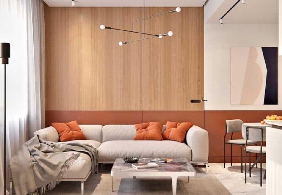 cores quentes para decoração de sala moderna com revestimento de madeira para parede  Foto Futurist Architecture