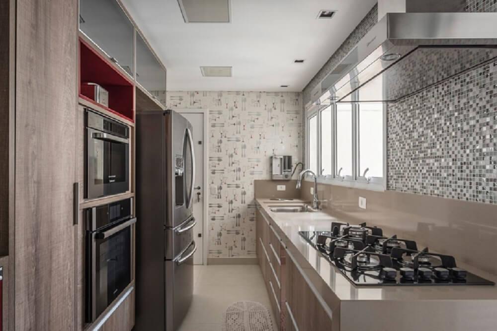 Balcão de cozinha na cor cappuccino com cooktop embutido