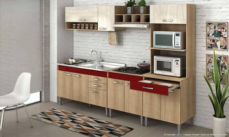 cozinha vermelha com armário com detalhes