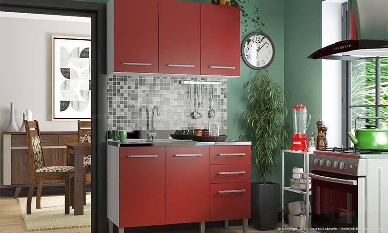 cozinha vermelha com armário e parede verde