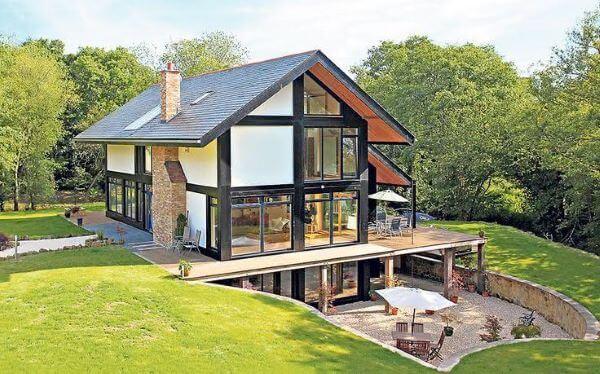 Casas de campo com janelas de vidro
