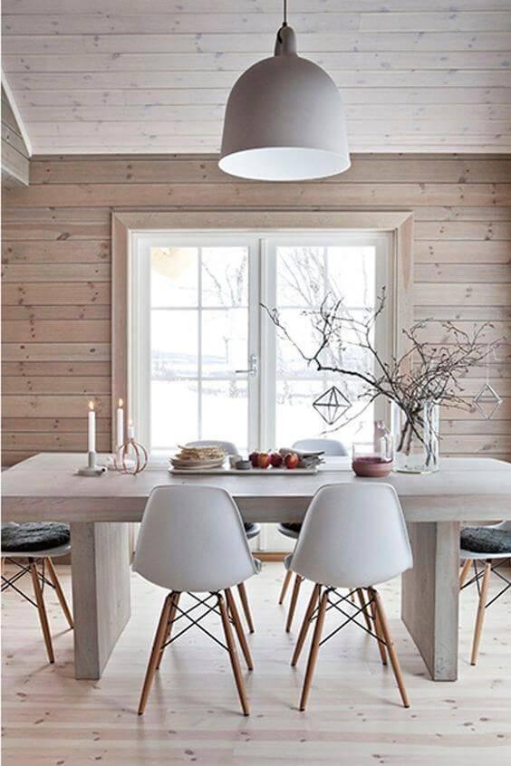 Decoração escandinava de sala de estar com pendentes
