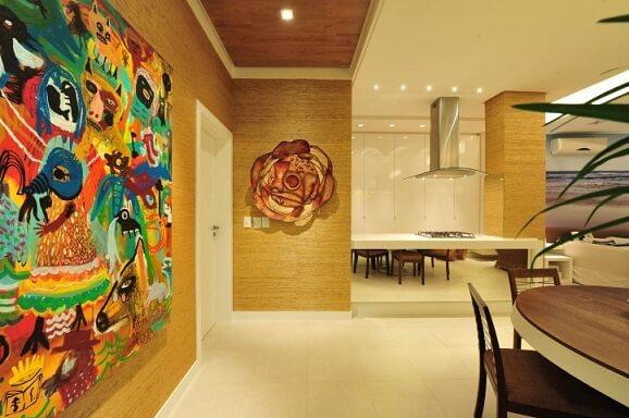 Sala com textura de parede e quadros Projeto de Anna e Anderson