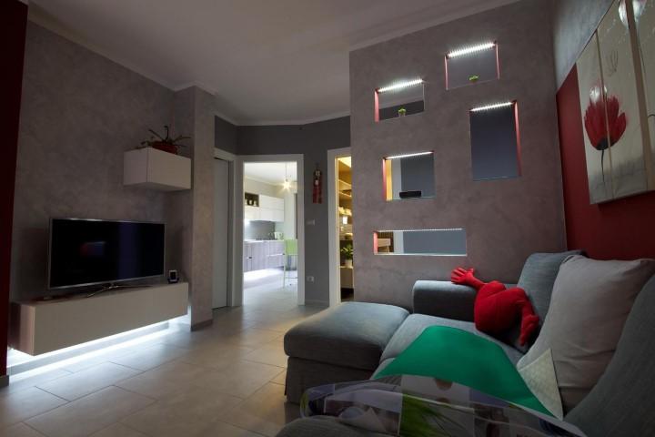 Sala de estar com textura de parede Projeto de Gabriele Barotto