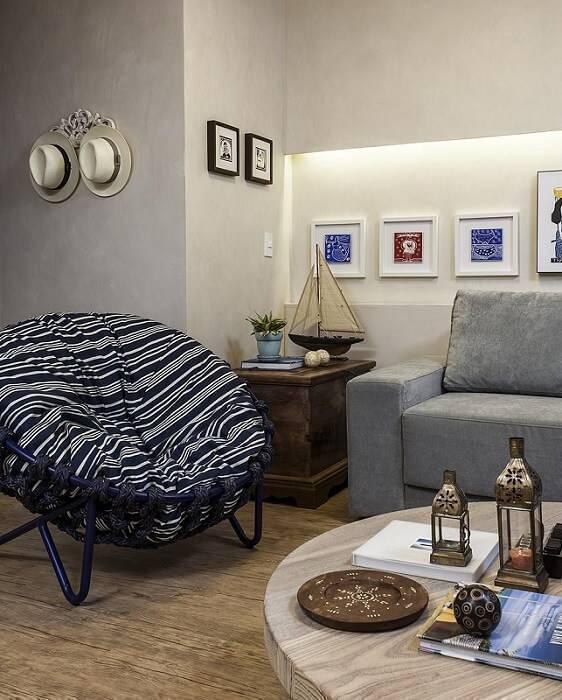 casa de praia sala de estar com quadros gabriele luiz 25857