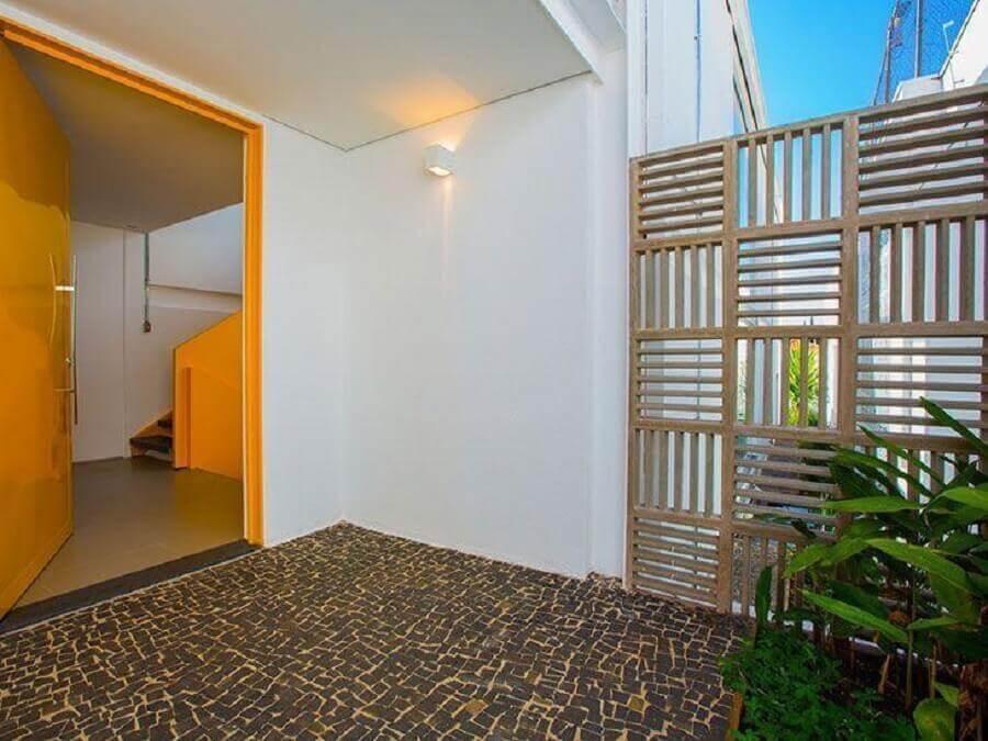 área externa com cobogó de concreto Foto Yta Arquitetura
