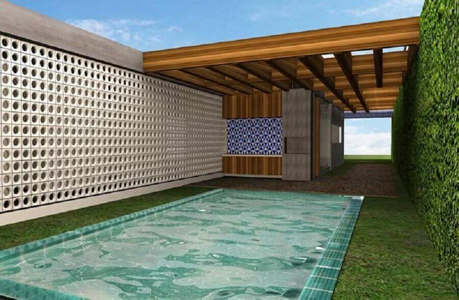 área externa decorada com parede de cobogó e piscina Foto Neu dekoration stile