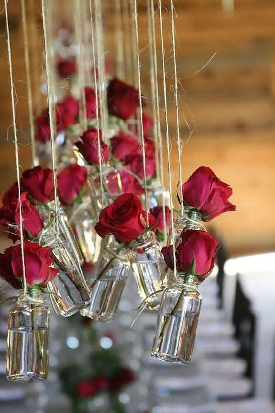 Decoração de festa de 15 anos - Vaso com rosas vermelhas