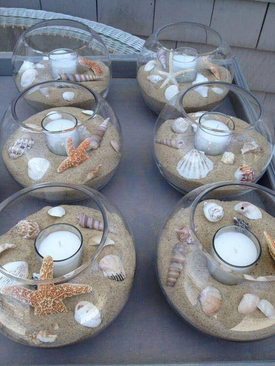 decoracao de festa centro de mesa com conchas