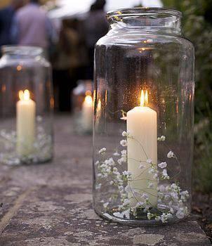 decoracao de festa pote com vela e mosquitinho