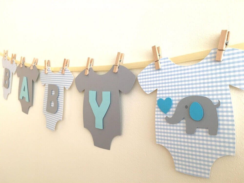 idea of decoration for diaper tea with clothesline Foto Smile Love