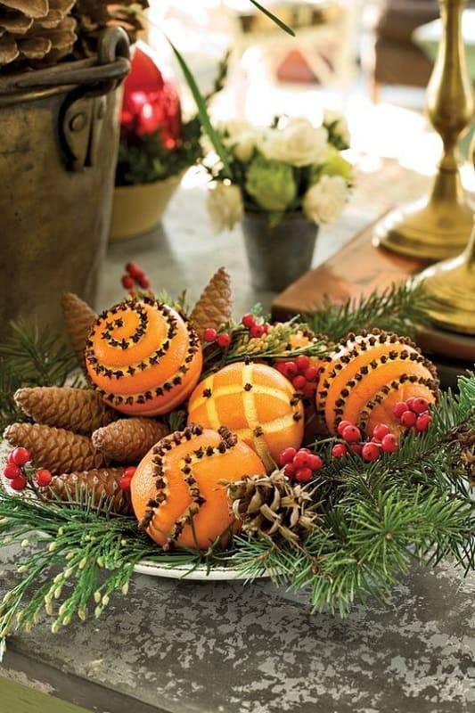 arranjos de natal para mesa com laranjas e cravos