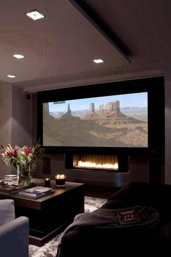 cinema em casa com lareira embutida