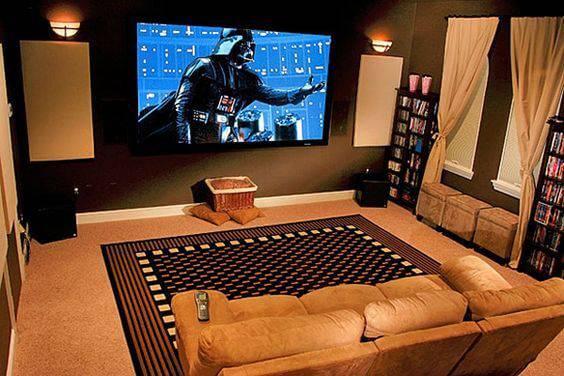 cinema em casa sofa com pufes