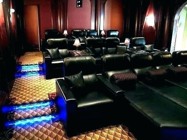 Poltronas em tom preto para sala de cinema