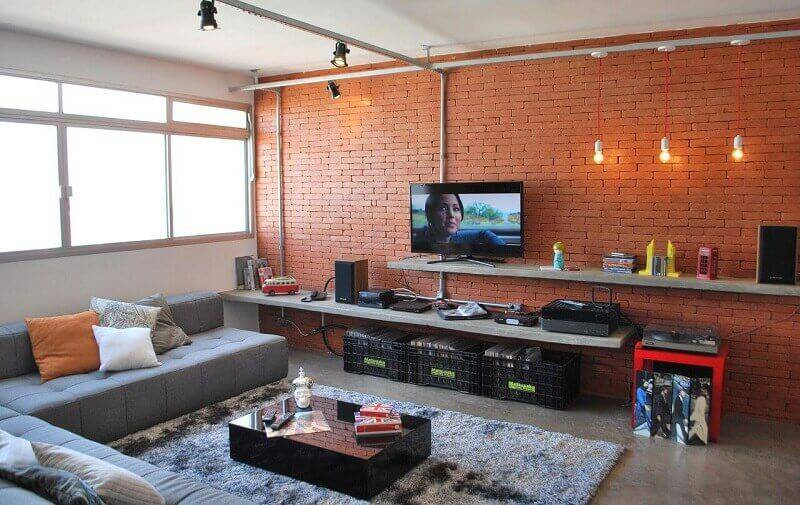 sala planejada com estante de concreto projeto de Projética Design e Arquitetura