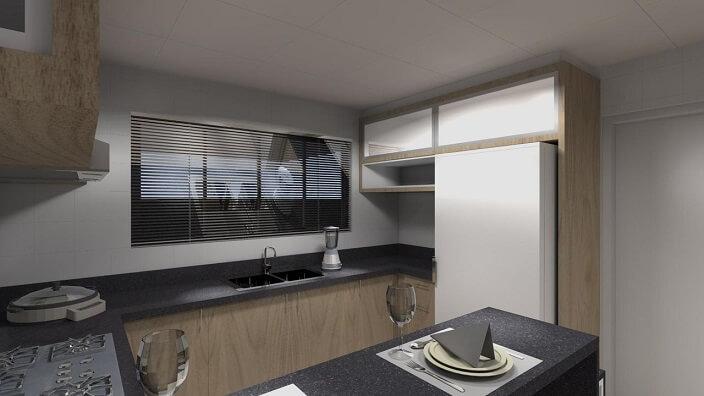 Pia de cozinha em granito preto em cozinha com bancada toda preta Projeto de Juliana Lahoz