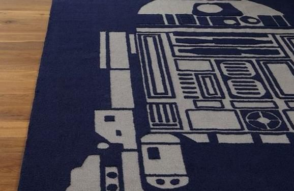 Quarto de gamer com tapete de R2D2