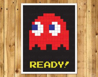 Quarto gamer com quadro do Pacman