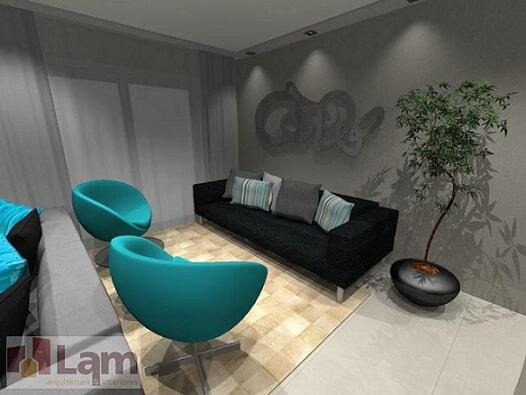 Sala de estar com sofá preto e poltronas azul turquesa Projeto de Lam Arquitetura