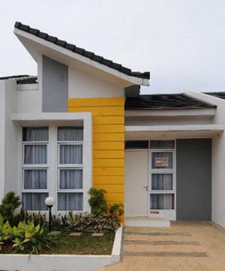 fachada de casa pequena com tom amarelo