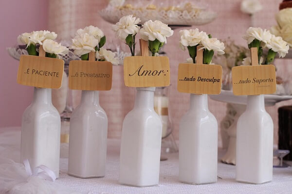 Spread bottles with flowers around the party room