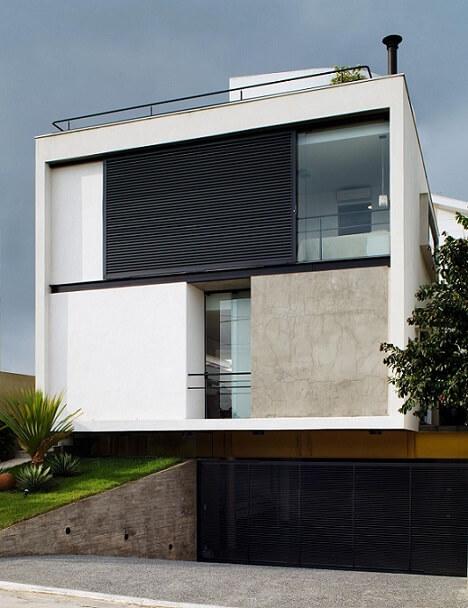 Fachadas de sobrados moderno com garagem subterrânea Projeto de FC Studio