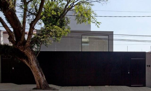 Frente de casas modernas com muro Projeto de Fabiana Freire