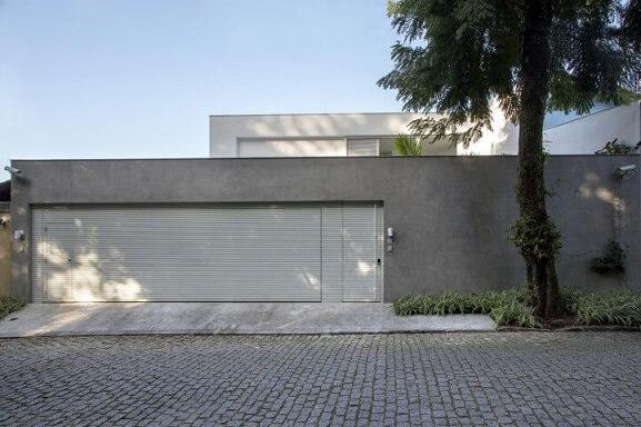 Frente de casas modernas com muro Projeto de Gisele Taranto