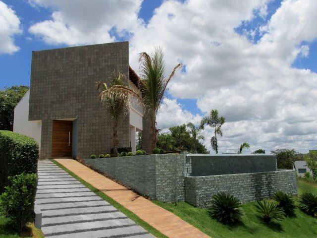 Frente de casas modernas com muro Projeto de Mutabile