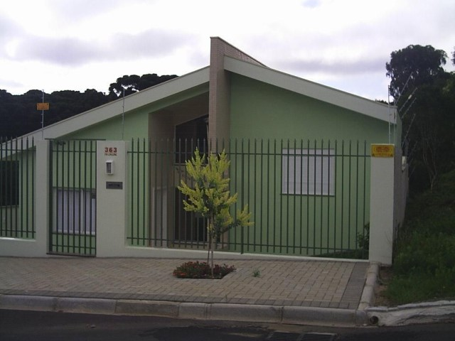 Frente de casas pequenas verde Projeto de Patricia Silveira Zat Leal
